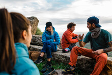 Group Of Active Climbers Enjoying Pastime Together