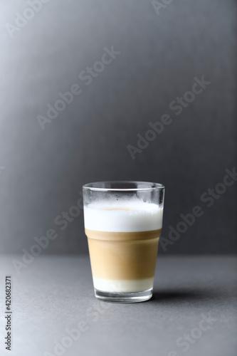Fototapeta Coffee with milk on gray background. Close up. Copy space. obraz