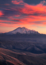 Mountain In Sunset Color With Hills In The Foreground