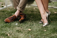 Close Up Of Man And Womans Feet On The Grass