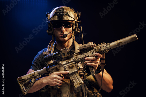 Vászonkép Special forces soldier with rifle on black background