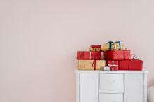 Stack Of Christmas Gifts On Cupboard