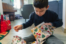 Boy Opening A Gift For Christmas