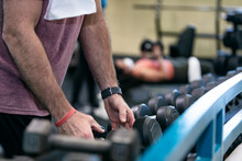 Gym: Man Ready To Work Out With Dumbbells