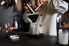 The Process Of Making Hand-made Coffee At Home In A Dark Home Atmosphere