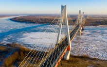 Aerial View Of Multispan Cable-stayed Murom Bridge Across Ice Covered Oka River On Sunny Winter Day, Vladimir Region, Russia.
