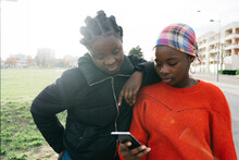 Two Teenagers Using Their Phone