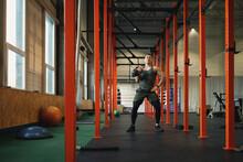 Man Pumping Iron At Empty Gym
