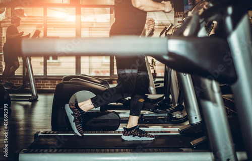 Running in a gym on a treadmill. Exercising concept. Fitness and healthy lifestyle.