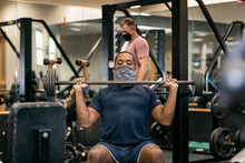 Gym: Man With Face Mask Lifting Barbell