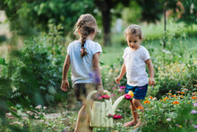 Little Gardeners Pouring Water
