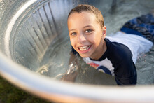 Boy In Pool Smiles At Viewer