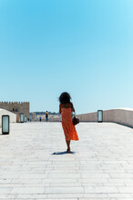 Young Woman Walking On Stone Bridge
