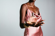 Anonymous African American Woman Showing Perfume