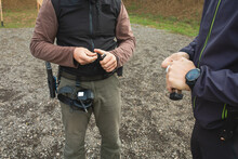 Two Shooters Are Putting Bullets Into Gun Cartridges On A Practical Shooting Training