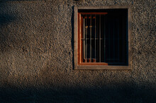 Window With Metal Bars Lit By Sunset