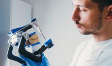 Dental Technician Making New Dental Prosthetics In Laboratory.
