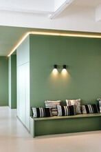 Interior Project With Green Walls And Textural Cushions