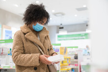 Costumer Wearing Medical Mask At Drugstore