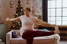 Adult Yoga Woman Coach Doing Christmas Yoga At Home