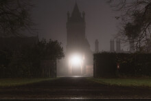A Spooky Victorian Building And Tower. On A Foggy, Winters Night.