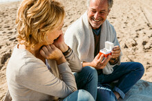 Mature Couple Propose At The Fall Beach Morning