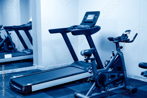 Fotografie, Obraz Indoor treadmill without use in blue business tone