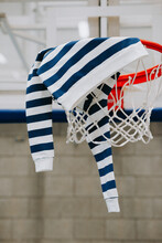Striped Sweater On A Basketball Ring