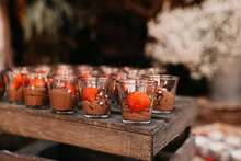 Chocolate Mousse Served In Small Glass Jars With Strawberries On Top
