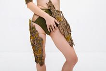 Slim Female Model With Tree Bark On Body