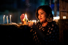 Portrait Of Young Lady Lighting Candles On Diwali