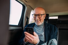 A Man In His 50s Texting In The Car
