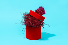 Red Gift Box Full Of Tinsel
