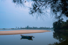 Tranquil Landscape - Fishing Boat In The Middle Of Lagoon
