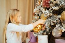 Adorable Teen Girl Decorates The Christmas Tree