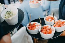Waiter Serving Tomatoes Dish