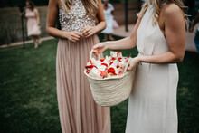 Bridesmaids Holding A Rotan Bag With Flower Confetti