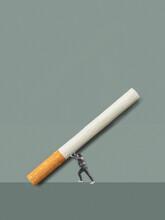 Person Holding A Bi¡g Cigarette