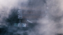Top-view Of Four Empty Cargo Ships Covered With Fog