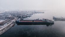 Top-view Of A Parked Cargo Ship In The Port