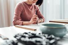 Asian Woman Writing Calligraphy