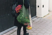 Woman Holding Mesh Bags