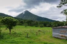 Arenal Volcano With Farm Landscape In Costa Rica