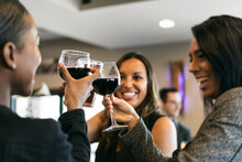 Restaurant: Women Smiling And Laughing While Drinking Wine