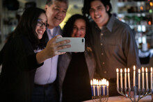 Hanukkah: Family Joins Together For A Holiday Photo