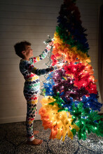Girl In Heart Pjs Adds Lights To Christmas Tree