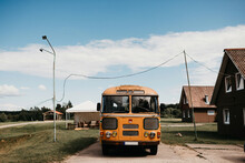 Old Yellow School Bus In A Village In Latvia