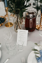 Table Set Up With Dutch - Russian Sentences Translated For International Wedding Guests