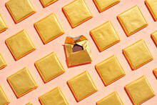 Pieces Of Chocolate In Golden Foil