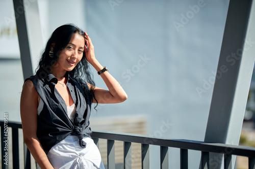 Fotografija Close-Up fashion portrait of young woman posing in the corridor